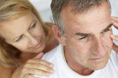 Woman comforting anxious husband — Foto Stock