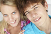 Teenage boy and girl head and shoulders — Stock Photo