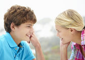 Teenage girl and boy head and shoulders in profile — Stock Photo