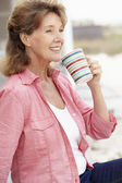 Senior woman relaxing outdoors — Stock Photo