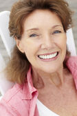 Senior woman head and shoulders — Stock Photo