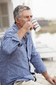 Senior man relaxing outdoors — Stock Photo