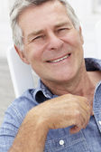 Senior man head and shoulders — Stock Photo