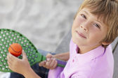 Young boy outdoors with bat and ball — Stock Photo