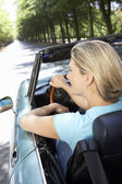 Woman in sports car — Stock Photo