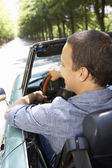 Man in sports car — Stock Photo