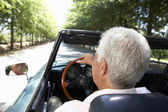 Senior man in sports car — Stock Photo