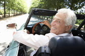 Senior man in sports car — Stockfoto