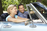 Couple in sports car — Stock Photo