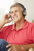 Mid age man wearing headphones — Stock Photo