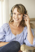 Mid age woman wearing headphones — Stock Photo