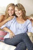 Mid age woman and teenage daughter at home — Stock Photo