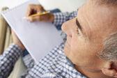 Mid age man sketching — Стоковое фото
