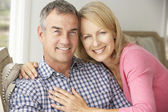 Mid age couple at home — Stock Photo
