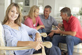 Mid age couples relaxing at home — Foto Stock