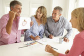 Mid age couples painting with watercolors — Stock Photo
