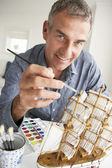 Mid age man model making — Stock Photo