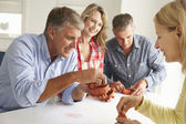 Mid age couples clay modelling — Stock Photo