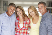 Mid age couples relaxing at home — Stock Photo