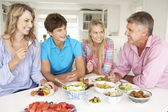 Family enjoying meal at home — Stock Photo