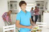 Teenagers helping with housework — Stok fotoğraf