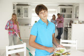 Teenagers not enjoying housework — Stock Photo