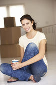 Woman moving into new home — Stock Photo