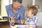 Senior man model making with grandson — Stock Photo