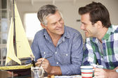 Adult father and son model making — Stock Photo