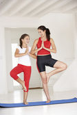 Mother and daughter doing yoga — Stock Photo