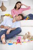 Exhausted parents resting — Stock Photo
