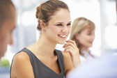 Young businesswoman in meeting — Stock Photo