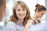 Mid age businesswoman in meeting — Stock Photo
