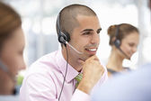 Young businessman wearing headset — 图库照片