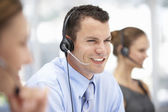 Young businessman wearing headset — Stock Photo