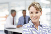 Mid age businesswoman — Stock Photo