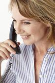 Mid age businesswoman on phone — Stock Photo