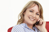 Mid age businesswoman using cellphone — Stock Photo