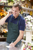 Man working in florist — Stock Photo