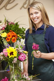 Woman working in florist — Stock Photo