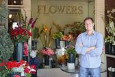 Man standing outside florist — Stock Photo