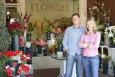 Couple standing outside florist — Stock Photo