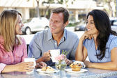 Friends chatting outside café — Stock Photo