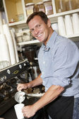 Man working in coffee shop — Stock Photo