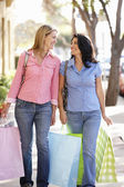 Women carrying shopping — Stock Photo