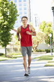 Man running in city park — Stock Photo