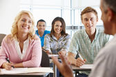 Tutor with class of students — Stock Photo