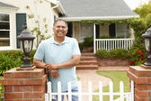 Senior Hispanic man outside home — Stock Photo