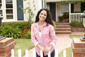 Young Hispanic woman outside home — Stock Photo