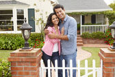 Hispanic couple outside home — Stock Photo